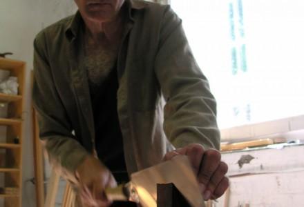 Hans Cutting the Soundboard